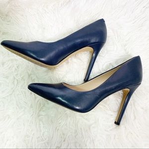 Vince Camuto pointed toe leather blue heels.